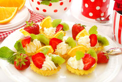 Mini tartlets with whipped cream and fruits Royalty Free Stock Photography