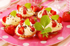 Mini tartlets with whipped cream and strawberry Royalty Free Stock Photo