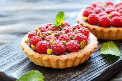 Mini tarts with chocolate, raspberry and pistachio. Royalty Free Stock Photography