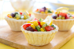 Mini tarts with corn, beans and avocado salad for holiday Stock Photography