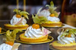 Mini tarts with fresh physalis and cream Stock Photo