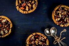 Mini tarts with nuts and caramel Royalty Free Stock Photos