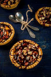 Mini tarts with nuts and caramel Stock Images
