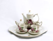 Mini tea set. On white background Stock Image