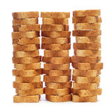 Mini toasts. Some piles of mini toasts on a white background Stock Photography