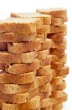 Mini toasts. Some piles of mini toasts on a white background Stock Photos