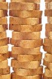 Mini toasts. Some piles of whole-wheat mini toasts on a white background Royalty Free Stock Photo