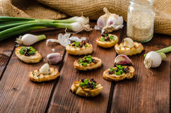 Mini toasts with garlic and dried tomato Stock Photography