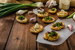 Mini toasts with garlic and dried tomato Royalty Free Stock Photos