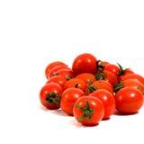 Mini tomate de cereza aislado Imagen de archivo