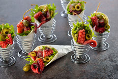 Mini tortillas with octopus salad Stock Photography
