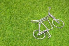 Mini toy bicycle and tree stump on a grass Stock Image