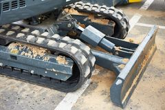 Mini tractor with loader stock images