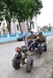 Mini-tractor in village street Stock Photo