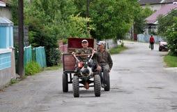Mini-tractor in village street_2 Stock Photos