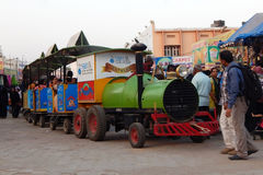 Mini train ride in amusement park Stock Photo