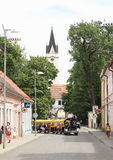 Mini Train in Trebon. Tourists having a tour with mini train car in front of the Trebon Castle entrance with tall clock tower, South Bohemia Royalty Free Stock Photos