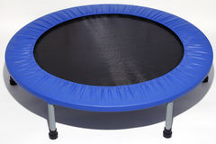 Mini Trampoline, Rebounder. Low impact exercise equipment you can bounce on used to increase lymph flow, tone muscles, and more Royalty Free Stock Images