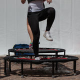 Mini Trampoline Workout: Girl doing Fitness Exercise in Class at Royalty Free Stock Image