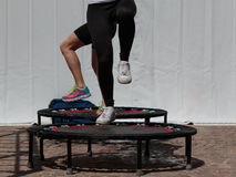 Mini Trampoline Workout: Girl doing Fitness Exercise in Class at. Gym stock photo