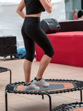 Mini trampoline workout: girl doing fitness exercise in class at gym.  stock photography