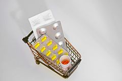 Mini trolley with different pills. stock images