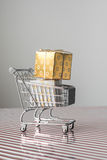 Mini trolley with gold christmas present Royalty Free Stock Image