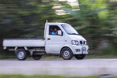 Mini truck panning camera in road royalty free stock photography