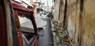 Songkla, Thailand - Jan.27 ,2018 : Mini truck taxi drove through narrow alley in old town. Mini truck taxi drove through narrow alley in old town. Songkla, the royalty free stock image