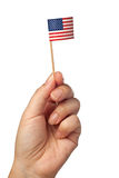 Mini United States of America flag. Hand waving a mini United States of America flag isolated on white background Stock Image