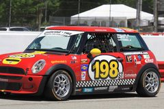 Mini USA racing. Sarah Cattaneo races the Mini Cooper S at the professional motorsports racing event, International Motor Sports Association, Sports car club of Stock Photography