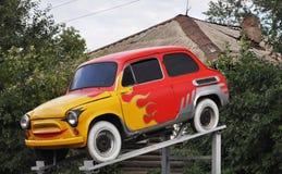 Mini véhicule, aerography : symboles de l'incendie Photos stock
