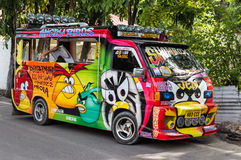 Mini van with colourful cartoon painting Royalty Free Stock Image