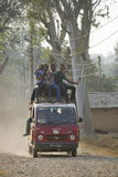 Mini van over charge of people in Nepal Royalty Free Stock Photos