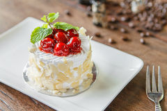 Mini vanilla cream cake with almond and cherry. Royalty Free Stock Image
