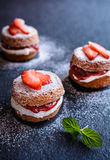 Mini Victoria Sponge Cakes With Whipped Cream And Strawberries Stock Photo