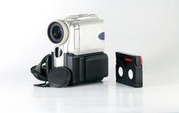 Mini videocámara con la cinta Imagen de archivo