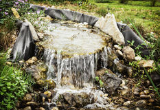 Mini waterfall in the city park, natural scene Royalty Free Stock Images