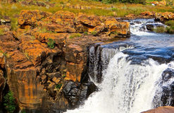 Blyde River Waterfall. A small waterfall against red iron rocks in Blyde River Canyon, South Africa stock photography