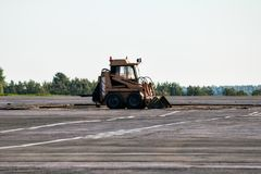 Mini wheel loader. At the airfield stock image