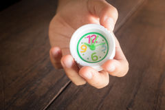 Mini white clock in hand Royalty Free Stock Photos