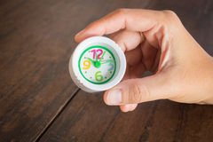 Mini white clock in hand Stock Images