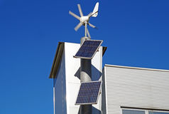 Mini wind power and solar panels for domestic use.  Stock Photos