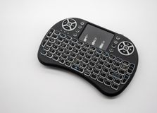 Mini wireless keyboard with track pad isolated on white background royalty free stock photography