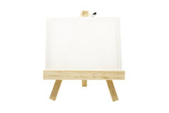 Mini wooden easel with blank canvas frame isolated. On white background Stock Photos