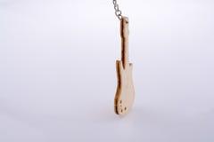 Mini wooden toy guitar model Royalty Free Stock Photos
