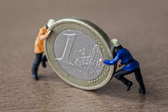 Mini Workers And Money Stock Photos