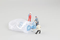 Mini workman moving of chocolate with hand Stock Images