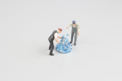 Mini workman moving of chocolate with hand Royalty Free Stock Images
