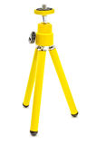 Mini yellow tripod isolated Royalty Free Stock Images